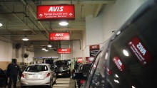 Cars sit in a lot at an Avis rental car branch in Manhattan on January 2, 2013 in New York City.
