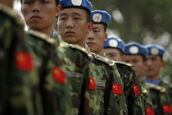 China's Defense Ministry has put its army on high alert following the ethic violence in the border towns of China and Myanmar.