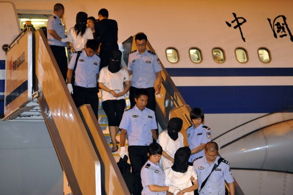 Malaysia Deports Taiwanese suspects to China.