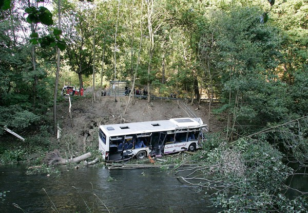 A passenger bus carrying 20 passengers in China plunged into a roadside lake, killing 18 people and hospitalizing two more.