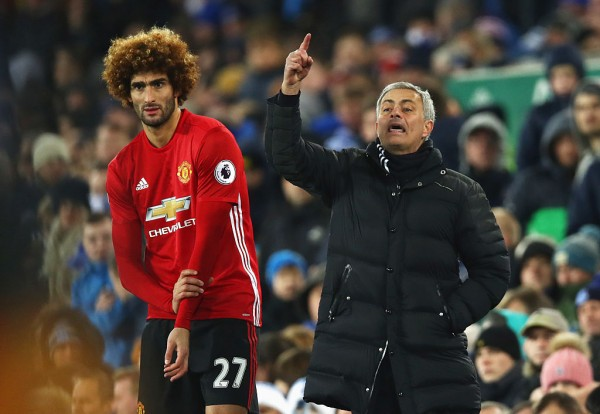 Manchester United midfielder Marouane Fellaini (L) with manager Jose Mourinho