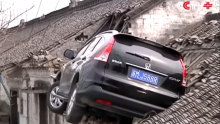 A Vehicle Crashes onto Roof in China.