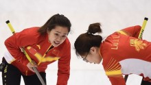 Chinese curlers Wang Rui (L) and Liu Jinli