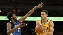 Minnesota Timberwolves' Andrew Wiggins (L) and Golden State Warriors' Stephen Curry