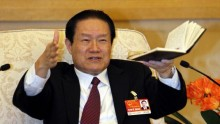 Chinese former Politburo Standing Committee Member Zhou Yongkang gestures as he speaks at a group discussion of Shaanxi Province during the National People's Congress at the Great Hall of the People.
