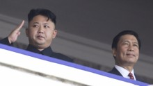North Korean leader Kim Jong-un salutes as he watches a Pyongyang parade with Chinese Vice President Li Yuanchao.