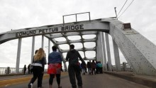 People join march across Selma, Alabama bridge to commemorate