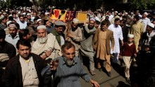 Men carry the coffin of Samiullah Afridi, who was killed by unidentified gunmen a day earlier, during his funeral in Peshawar March 18, 2015.