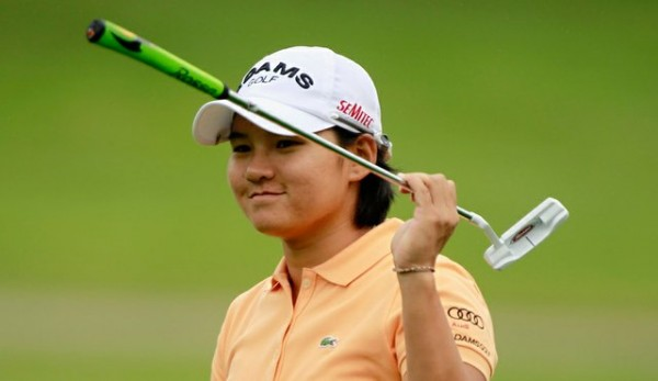 Yani Tseng of Chinese Taipei sinks a 12-foot birdie putt on the 18th hole to win against the United States