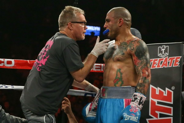 Freddie Roach (L) and Miguel Cotto