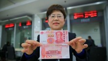 Chinese New 100 Yuan Notes Wheeled Out