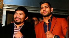 Manny Pacquiao (L) and Amir Khan