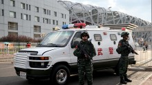 A general view of security personnel outside Beijing National Stadium