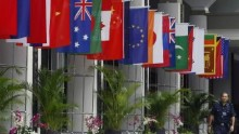 A police officer walks past the national flags of countries attending the Association of Southeast Asian Nations (ASEAN) Ministerial Meeting and ASEAN Regional Forum in Singapore in this July 2008 file photo.