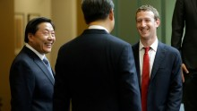 hinese President Xi Jinping (C) talks with Facebook Chief Executive Mark Zuckerberg (R) as Lu Wei, China's Internet czar, looks on during a gathering of CEOs and other executives at the main campus of Microsoft Corp Sept. 23, 2015 in Redmond, Washington.