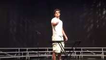 Mike Senatore flips a water plastic bottle during a high school talent show in North Carolina.