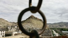 The former local government palace is framed by an iron ring in Gyantse township of Tibet, China.