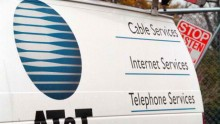 The AT&T logo is seen on the side of a service van in Des Plaines, Illinois.