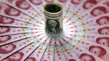 Chinese currency touched its lowest level in six years against dollar during early Monday morning session.