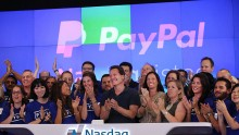 PayPal President and CEO Dan Schulman (center) joins employees, customers and Nasdaq employees while ringing the bell at Nasdaq this morning on July 20, 2015 in New York City.