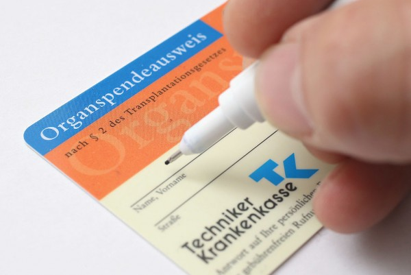 In this photo illustration a real organ donor's card (Organspendeausweis) from public health insurer Techniker Krankenkasse is seen on November 13, 2012 in Berlin, Germany.
