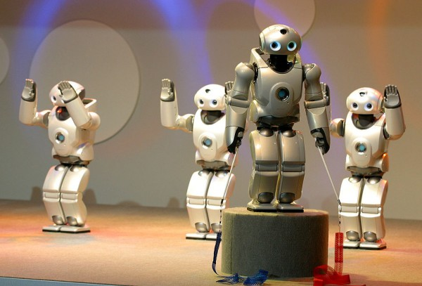Sony's SDR-4X II robots perform on a stage at Robodex2003 April 2, 2003 in Yokohama, Japan.