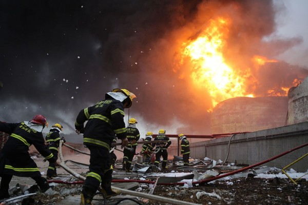 Firefighters battle a fire at the explosion site of PX chemical plant on April 7, 2015 in Zhangzhou, China.