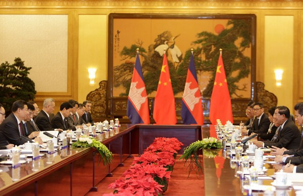 Cambodia's Prime Minister Hun Sen (2nd R) and China's President Xi Jinping (L) attend a meeting at the Great Hall of the People on November 7, 2014 in Beijing, China.