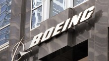 The Boeing logo hangs on the corporate world headquarters building of Boeing November 28, 2006 in Chicago, Illinois.